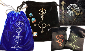 4 drawstring dice bags featuring vulcan writing.  1 of the bags is a velvety blue, and 1 is a velvety black.  2 are a more canvas type texture.  There is also a small square bit of another bag with vulcan writing and related imagery.