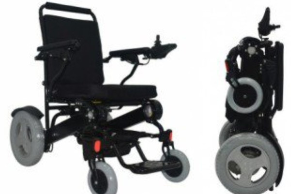 A slightly out-of-focus of a foldable power wheelchair