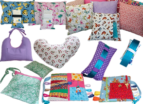 Various square and small rectangular pillows, with and without ice pack inserts.  2 different post mastectomy pillows, one heart shaped, one u shaped with a tie at the top. 2 different seatbelt-attachable pillows, a drain pouch in floral fabric, and 2 different fidget blankets.