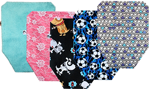 5 ostomy covers in various fabrics and patterns including a teal terry cloth, pink with white lace overlay, black with cartoon dogs, blue with soccor balls and purple, gray, white and teal hearts.
