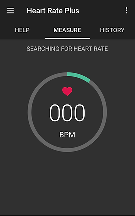 """Screenshot of Heart Rate Plus App, a dark gray screen with wide black header.  In white the header has a navigation button to the top left, text reading, """"Heart Rate Plus,"""" and a menu button to the top right.  Below the title are 3 tabs for """"Help,"""" """"Measure"""" and """"History.  Measure is selected and indicated by a white underline.  Below in the gray is white text that reads, """"Searching for heart rate""""  A large gray outline of a circle is in the center with part of the outline in green.  Inside the circle is a small pink heart, white text reading """"000"""" and """"BPM"""""""