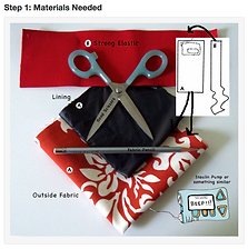 A stack of fabric pieces with a pair of open scissors on top