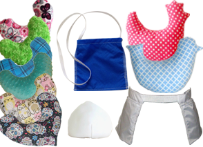 A column of different patterned v shaped pillows, a royal blue drain pouch, a white breast form, a chicken and bird haped checker patterned pillows, and a white belt with a pouch on each side for drains.