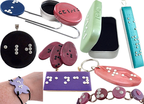 Necklaces, Bracelets, bookmaks and small tins with braille dot lettering on  them