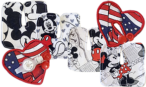 A mix of 6 g tube/trach pads.  4 have mickey mouse themed patterns, and 2 are heart shaped with patriotic USA Flag themes.