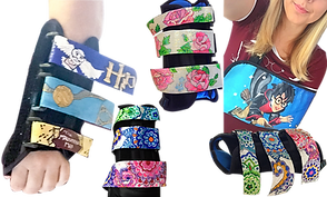 4 black arm/wrist braces whose velcro overstraps have been handpainted with designs. One has a harry potter theme, 1 with roses, and the 3rd and 4th with green, blue, and pink paisley.  A woman wears a harry-potter painted arm sling.