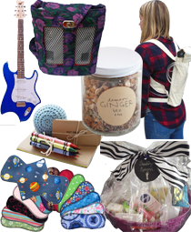 A wheelchair friendly blue and white guitar, an oxygen pump in a purse-styled bag, a jar of ginger tea, a persn wearing an oxygen tan in a canvas backpak, a calming it with crayons, a notebook and stress ball, a fanned selection of cloh menstrual pads and a spoonie-themed gift basket wrapped with a zebra patterned bow.