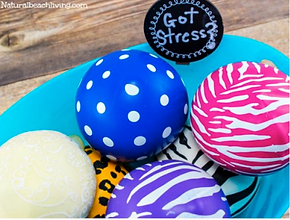 "A bowl of different patterned stress balls.  It has a sign reading, ""Got Stress"""