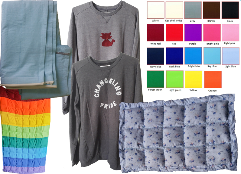 "A color cart with 16 color options, a folded but empty weighted blanket, 2 sweatshirts- one featurin a small red cat with neurdivergent infinity symbol bow-tie, and one reading, ""Changeling Pride,"" a long rainbow colored weigted blanket, and a blue floral weighted lap blanket."