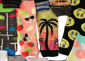 Varius different sock-like itms with different fun, colorful designs made to cover children's picc lines.