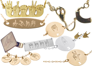 Various gold and silver jewelry wih Israeli Signs forming differentname and letters, and a gold cochlear implant necklace.