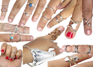 A myriad of fingers wearing a range of silver and gold ring splints. There are several plain splints, some with gemstones, some with hearts or cat shapes, several thumb stabilizers and a variety of styles