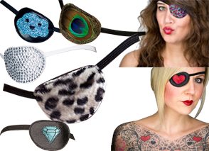 5 eyepatches: 1 black with a blue smiling glittery coud on it, one blck wih a peacock feather on it, 1 white with silver rhinestones, 1 black with soft black and white leopard spots, 1 black with a blue diamond illustration, 2 white female presenting persons with eyepatches: 1 black with multi-color purple/pink sparkles, and one with a black patch with red heart on it.