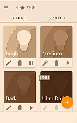 "Screenshot of Night Shift App, a pale yellow screen with menu icon in the top left corner next to the words, ""Night Shift"" in dark brown.  Below is the word ""FILTERS"" in bold and the word ""Schedule.""  filters is the selected option indicated by an orange line below it.  The bottom section of the screen has 4 options illustrated.  ""Bright, Medium, Dark, "" and ""Ultra Dark""  Each option has 3 setting icons- a pencil icon, a trash icon and a pause button.  The Ultra Dark option has a small flag over it reading ""PRO"" and in the bottom right corner, partially over the Ultra Dark option is an orange circle with a white + in it."