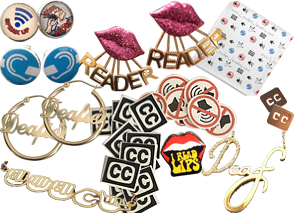 Various pairs of earrings, pins and stickers with Deaf culture themes.  Some have Lips ith the word Reader attached some with the international symbol for D/deafness and HOH, different CC icons, and jewelry reading Deafie