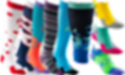 5 knee high compression socks in varying wild patterns and colors, 1 calf sleeve in a blue and green abstract pattern, and three ankle height compression socks in contrasting colors.