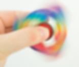 A fidget spinner in rainbow colors in action.