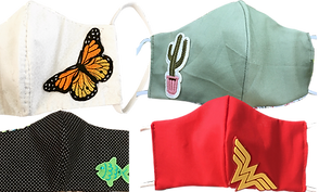 4 cotton masks with different accents.  The top to are white wiht a monarch butterfly and a green with cactus patch, and the bottom are a black with white dots and a green fish patch, while the bottom right is all red with a wonder woman emblem.