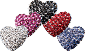 6 bejeweled metal hearts to attach to hearing aids, one diamond-style jewels, one pink, one black, one red, and one blue.