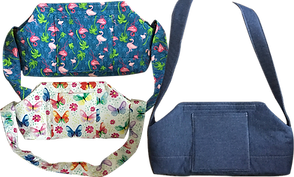 3 over-shoulder sytyle purses designed to hold oxygen tanks.  One is patterned with flamingos, one with butterflies, and one in blue denim.