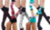 5 pairs of legs wearing knee-high compression socks.  Their patterns are black with red dots, black gred and gray argyle, black and gray with dogs and pawprints, teal white yellow and navy stripes, and black with pink hearts.