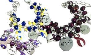 "3 beaded bracelets with lots of dangling beads and charms.  The first is in purple tones, the second in blue and yellow and the third in reds.  Some of the charms read, ""inspire,"" ""love,"" ""hope,"" ""dream,"" ""Courage."""