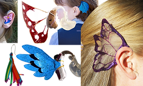 3 people's ears with hearing aids that have wings attached to them. 1 is styled like dragon wings, one like a butterfly, and one has an actual butterfly charm on the in-ear part of the aid.  A rainbow-colored fob of ribbons styled to fit like an earring over a hearing aid tube, and 2 different kinds of wings shown attached to hearing aids.