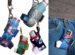 5 ihalers shown i decorativ cases with clasps that allow attachement to other items.  A close up of a person's upper jeans and t-shirt hem, displaying another inhaler holster clipped to a belt loop.
