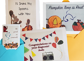 """4 greeting cards, 2 partly tucked in envelopes and 2 loose.  Left to Right they read, """"Be Good to Yourself,"""" """"I'll Share my Spons with You,"""" """"Congratulations on your diagnosis (finally)"""", and """"Pumpkin Time is Real."""""""