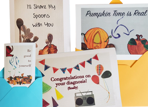 "4 greeting cards, 2 partly tucked in envelopes and 2 loose.  Left to Right they read, ""Be Good to Yourself,"" ""I'll Share my Spons with You,"" ""Congratulations on your diagnosis (finally)"", and ""Pumpkin Time is Real."""