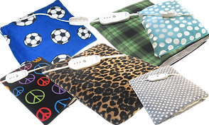 6 heating pads with different fabric covers.  One blue with soccor balls, one black with multi-colored peace signs, one leopard print, one green and black plaid, one light blue with silver dots, and one gray with white dots