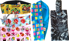 A row of 3 insulin pod belts, one with marvel characters, one with flowers and one with cupcakes.  Another displayed vertically with multi-colored tulip illustrations, and an arm band pouch with a lacy floral print in black over blue.