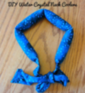 a fabric neckband that is blue with abstract shapes on it.