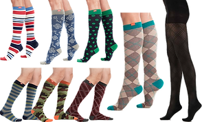 Top row is 3 different patterned knee socks, on the bottom 3 pairs of patterned mens knee high socks, next to the rows, a larger pair of argyle knee socks, and a pair of opaque black patterned stockings.