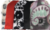 5 Ostomy covers, one with beareded heads, a red, a whtie with black flowers, one black, and one with a multicolor paisley pattern