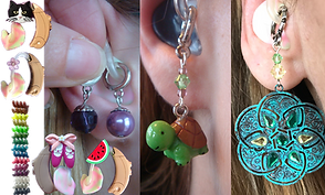 4 tan hearing aids with multicolor earpieces, one has a cat charm attached at the crest, one has a flower, another a pair of ballet slippers, and another a slice of watermelon, a row of curly plastic bits in different colors with glittery finishes, and 3 different women's ears with hearing aids in them- each has a different set of earring-like dangles.  One with small pearl rounds, one with a cute cartoony turtle, and one oxydized copper with inlaid crystals
