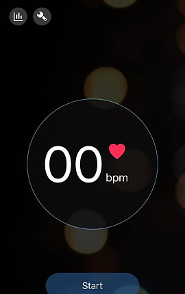 """Screenshot of Heart Rate Monitor App, a black screen with an icon for graphs and settings in the top left corner.  There is a large black circle with thin white outline towards the bottom of the screen with white text reading, """"00 bmp"""" and a small pink heart next to it.  At the bottom is a blue start button."""