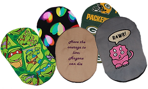 5 ostomy covers with varying themes and colors including sports teams, hearts, ninja turtles, sayings and embroidery.