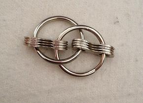 A fidget toy made of keyrings and bike chain parts.