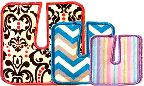 3 G-Tube pads in decreasing sizes.  One is off-white with black and red design and red border stitching, one is a blue, white and silver chevron pattern, and the smallest is a pastel multicolor vertical striped pattern.