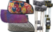 3 empty slings, one with mnm's candy fabric, one purple with multicolor fluorescent dots, and one gray abstract pattern.  Next to them are 2 pairs of crutches. One has pads and covers in a black and white paisley pattern, and the other has batman symbols.