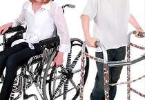 A wheelchair and a walker each decorated with vinyl decals.  The wheelchair has a zebra pattern and the walker has a sports themed pattern.
