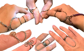 Several white hands/fingers wearing a variety of silver ring splints.