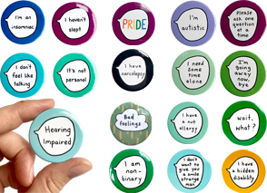 16 small rund pins with various sayings on them ranging from awareness to attitude about illnesses, symptoms, and conditions