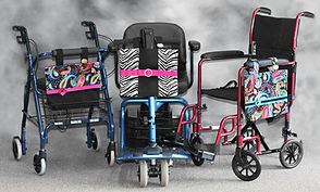 A rollator, a power scooter and a transfer chair each adorned by a different colorful bag.