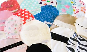 A photo of a range of ostomy covers in different sizes and fabrics.