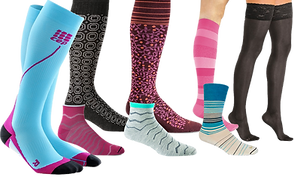 5 different knee-high compression socks, 2 ankle socks and 1 standard sock- all in different colors and patterns.
