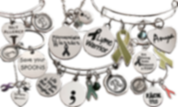 Bracelets, Necklaces and Keychains with various awareness themes. Some include awareness ribbons.  The tags reference Lyme, Lupus, Fibromyalgia, MS and more, and there are personalized tags with initials and names on them as well.