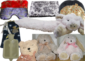 2 silky looking eye masks, a rectanglar heating pad in a black and white pattern, heating pads shaped for use around the neck, a long stuffed pig that can be heated and used as a heating pad, 2 stuffed anmals that can be microwaved and snugged, a teddy-bear head shaped fluffy heating pad, and an old-school rubber hot water bottle with a celestial fabric cover