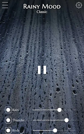 Screenshot of Rainy Mood App, an image of rain on a window with Rainy Mood Classic printed at the top in between a menu icon and a settings icon.  In the center is a pause button.  Towards the bottom are sliders to set the rina, thunder and bird levels.